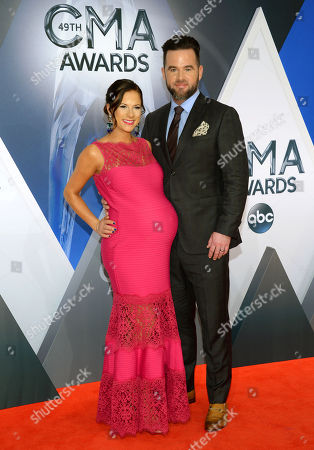 David Nail, right, and Catherine Werne arrive at the 49th annual CMA Awards at the Bridgestone Arena, in Nashville, Tenn