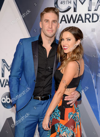 Shawn Booth, left, and Kaitlyn Bristowe arrive at the 49th annual CMA Awards at the Bridgestone Arena, in Nashville, Tenn