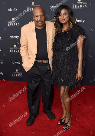 Former NFL player Jim Brown, left, and Monique Brown arrive at the 4th annual NFL Honors at the Phoenix Convention Center Symphony Hall on
