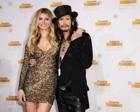 """Singer Steven Tyler, right, and model Marisa Miller arrive at the """"50 Years of Beautiful"""" television event celebrating the Sports Illustrated Swimsuit Issue's 50th Anniversary at the Dolby Theatre on in Los Angeles"""