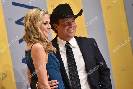 Clay Walker, left, and Jessica Craig arrive at the 50th annual CMA Awards at the Bridgestone Arena, in Nashville, Tenn