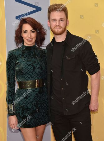 Stock Photo of Jeyda Beyzade, left, and Ben Haggard arrive at the 50th annual CMA Awards at the Bridgestone Arena, in Nashville, Tenn