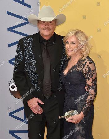 Stock Photo of Alan Jackson, left, and Denise Jackson arrive at the 50th annual CMA Awards at the Bridgestone Arena, in Nashville, Tenn