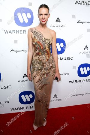 Masha Rudenko arrives at the Warner Music Group Grammy Awards After Party at Milk Studios, in Los Angeles