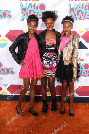 Stock Image of Singers (L-R) Sydney Schauble, Kennedy Stephens and Shelbi Schauble of Identity4Pop arrive at the 5th Annual TeenNick HALO Awards at the Hollywood Palladium on in Hollywood, Calif