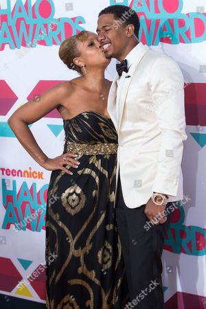Actor Nick Cannon (R) and mother Beth Gardner arrive at the 5th Annual TeenNick HALO Awards at the Hollywood Palladium on in Hollywood, Calif