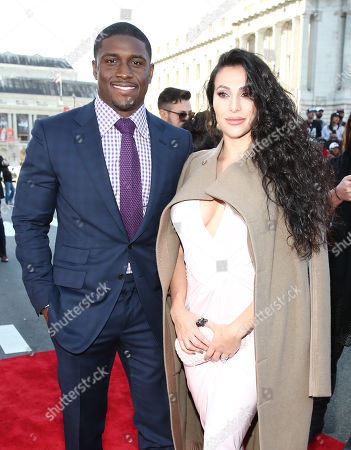 Reggie Bush of the San Francisco 49ers, left, and Lilit Avagyan arrive at the 5th annual NFL Honors at the Bill Graham Civic Auditorium, in San Francisco