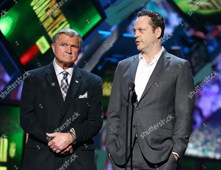 Former NFL player and coach Mike Ditka, left, and Vince Vaughn present the AP coach of the year award presented by Lenovo at the 5th annual NFL Honors at the Bill Graham Civic Auditorium, in San Francisco