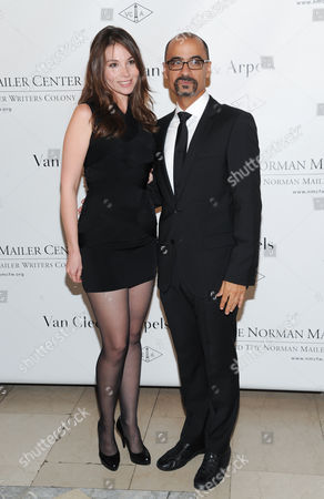 Stock Photo of Mailer Prize for Distinguished Writing recipient Junot Diaz and girlfriend Marjorie Liu attend the 5th annual Norman Mailer Center benefit gala at The New York Public Library on in New York