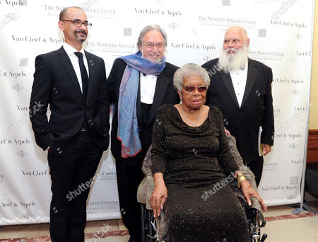 Lifetime Achievement Award honoree Maya Angelou, sitting, Mailer Prize for Distinguished Writing recipient Junot Diaz, back left, Norman Mailer Center president and co-founder Lawrence Schiller and writer Samuel R. Delany, right, attend the 5th annual Norman Mailer Center benefit gala at The New York Public Library on in New York