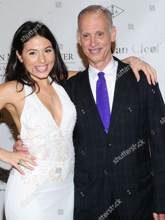 John Waters and Katrina Eugenia attend the 5th annual Norman Mailer Center benefit gala at The New York Public Library on in New York