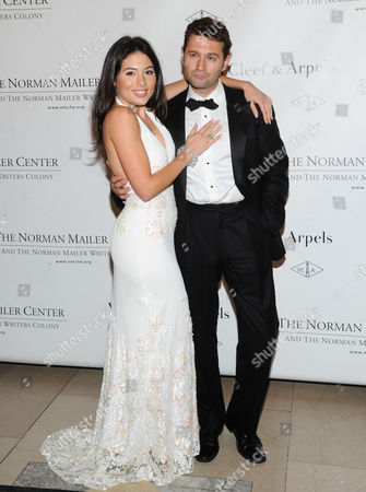 Author and playwright John Buffalo Mailer and girlfriend Katrina Eugenia attends the 5th annual Norman Mailer Center benefit gala at The New York Public Library on in New York