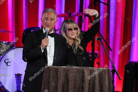 Del Bryant, BMI president, left, and Stevie Nicks speak on stage at the 62nd Annual BMI Pop Awards at the Beverly Wilshire Hotel, in Beverly Hills, Calif