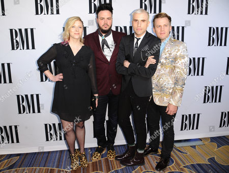 Elaine Bradley, from left, Branden Campbell, Tyler Glenn and Chris Allen, of Neon Trees, arrive at the 63rd annual BMI Pop Awards at the Beverly Wilshire Hotel, in Beverly Hills, Calif