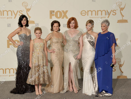 SEPTEMBER 18: (L-R) Jessica Pare, Kiernan Shipka, Elisabeth Moss, Matthew Weiner, Christina Hendricks, Cara Buono and Randee Heller pose in the press room at the Academy of Television Arts & Sciences 63rd Primetime Emmy Awards at Nokia Theatre L.A. Live on in Los Angeles, California