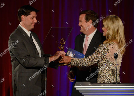 """Stock Image of AUGUST 11: KTTV Reporter Courtney Friel and KTLA Reporter Sam Rubin present the """"Sports Feature"""" award to producers Bruce Beffe, Tony Stefanelli and Christopher Witte of FOX Sports West for '50 Years Under The Halo: 2009 (50 Years Under The Halo)'onstage at the Academy of Television Arts & Sciences 64th Los Angeles Area Emmy Awards on in Los Angeles, California"""
