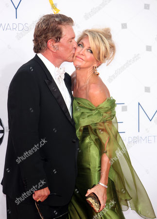 SEPTEMBER 23: Tom Berenger(L) and Laura Moretti arrive at the Academy of Television Arts & Sciences 64th Primetime Emmy Awards at Nokia Theatre L.A. Live on in Los Angeles, California