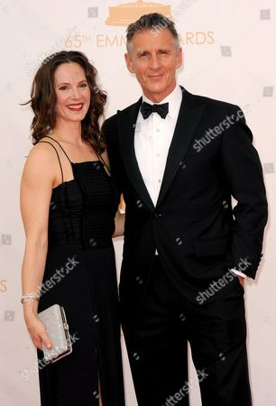 From left, Kim Stanley and Christopher Stanley arrive at the 65th Primetime Emmy Awards at Nokia Theatre, in Los Angeles