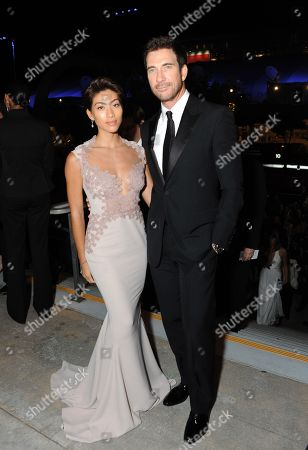 Shasi Wells, left, and Dylan McDermott pose for photos at the Governors Ball at the 65th Primetime Emmy Awards at the Nokia Theatre, in Los Angeles
