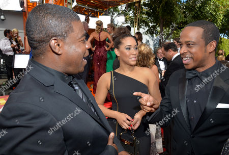 Stock Photo of From left, Tracy Morgan, Megan Wollover, and Keith Powell arrive at the 65th Primetime Emmy Awards at Nokia Theatre, in Los Angeles