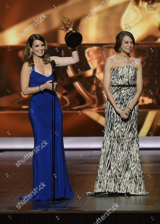 Tina Fey and Tracey Wigfield accept the award for outstanding lead actress in a comedy series for her role on â?oe30 Rockâ?? at the 65th Primetime Emmy Awards at Nokia Theatre, in Los Angeles