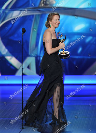 """Stock Photo of Sarah Bromell accepts the award for outstanding writing for a drama series for his work on """"Homeland"""" on behalf of her late husband Henry Bromell at the 65th Primetime Emmy Awards at Nokia Theatre, in Los Angeles"""