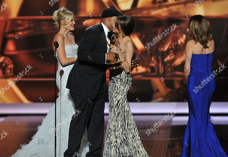 """From left, Malin Akerman and LL Cool J present Tracey Wigfield and Tiny Fey with the award for outstanding writing for a comedy series for their work on """"30 Rock"""" at the 65th Primetime Emmy Awards at Nokia Theatre, in Los Angeles"""