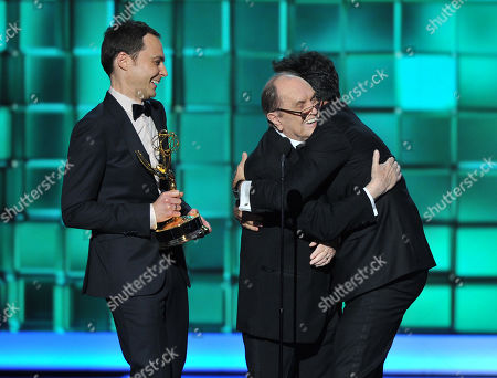 """Stock Photo of From left, Jim Parsons and Bob Newhart present the award for outstanding writing for a variety series to Steven Colbert for """"The Colbert Report"""" at the 65th Primetime Emmy Awards at Nokia Theatre, in Los Angeles"""