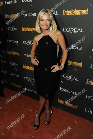 Kristen Chenoweth arrives at the 2013 Entertainment Weekly Pre-Emmy Party, presented by L'Oreal Paris and bebe at Fig & Olive, in Los Angeles