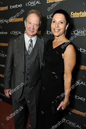 From left, Jeff Perry and Linda Lowy arrive at the 2013 Entertainment Weekly Pre-Emmy Party, presented by L'Oreal Paris and bebe at Fig & Olive, in Los Angeles