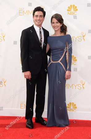 Ben Feldman, left, and Michelle Mulitz arrive at the 66th Primetime Emmy Awards at the Nokia Theatre L.A. Live, in Los Angeles