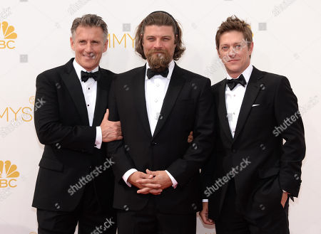 Christopher Stanley, and from left, Jay R. Ferguson and Kevin Rahm arrive at the 66th Primetime Emmy Awards at the Nokia Theatre L.A. Live, in Los Angeles
