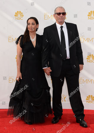 Catherine Rusoff, left, and Ed O'Neill arrives at the 66th Primetime Emmy Awards at the Nokia Theatre L.A. Live, in Los Angeles