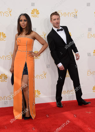 Kerry Washington, left and Aaron Staton arrives at the 66th Primetime Emmy Awards at the Nokia Theatre L.A. Live, in Los Angeles