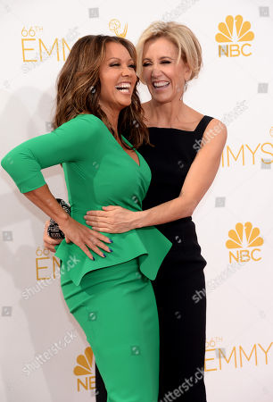 Vanessa L. Williams, left, and Felicity Huffman arrive at the 66th Primetime Emmy Awards at the Nokia Theatre L.A. Live, in Los Angeles