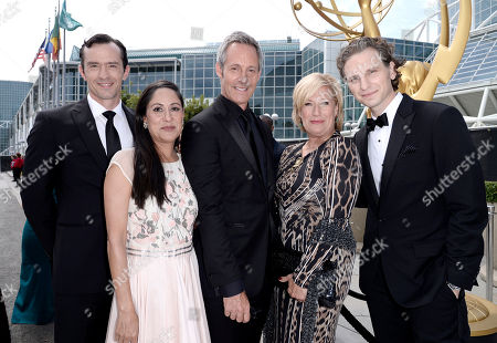 Nathan Darrow, and from left, Sakina Jaffrey, Michael Gill, Jayne Atkinson and Sebastian Arcelus arrive at the 66th Primetime Emmy Awards at the Nokia Theatre L.A. Live, in Los Angeles