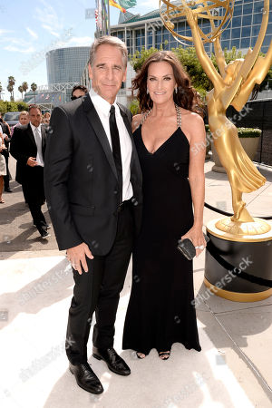 Scott Bakula, left, and Chelsea Field arrive at the 66th Primetime Emmy Awards at the Nokia Theatre L.A. Live, in Los Angeles
