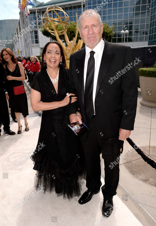 Catherine Rusoff, left, and Ed O'Neill arrive at the 66th Primetime Emmy Awards at the Nokia Theatre L.A. Live, in Los Angeles