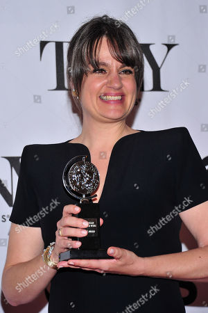Pam MacKinnon poses with her award in the press room at the 67th Annual Tony Awards, on in New York