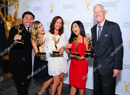 """Members of NBC4, Tony Shin, Crystal Egger, Marissa Sifuentes, Hetty Chang, and Patrick Healy, winners of the award for education for """"Running Dry: California's Historic Drought"""" pose for a portrait at the 67th Los Angeles Area Emmy Awards at the Skirball Cultural Center on"""
