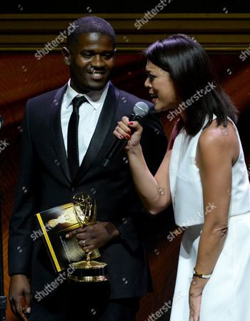 """Marcus Wilson-Smith, left, and Cher Calvin of KTLA5 accept award for live coverage of an unscheduled news event for """"UCLA Water Main Break"""" at the 67th Los Angeles Area Emmy Awards at the Skirball Cultural Center on"""