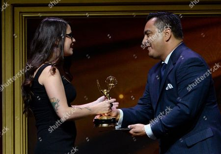 """Adrian Garcia Marquez, right, presents Cara Santa Maria of KCET the award for feature segment for """"Natural History Museum's Citizen Science Insect Labeling Project"""" at the 67th Los Angeles Area Emmy Awards at the Skirball Cultural Center on"""