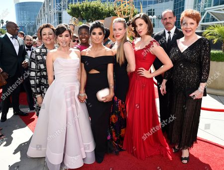 Barbara Rosenblat, from left, Yael Stone, Abigail Savage, Lolita Foster, Diane Guerrero, Emma Myles, Julie Lake, Nick Sandow, and Beth Fowler arrive at the 67th Primetime Emmy Awards, at the Microsoft Theater in Los Angeles