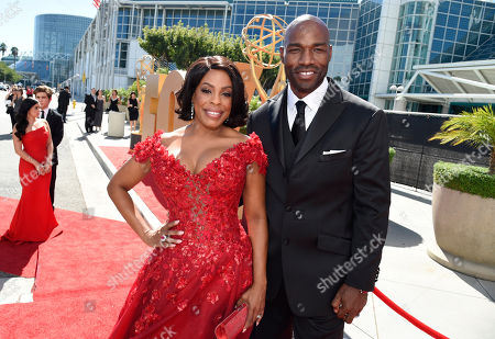 Niecy Nash, left, and Jay Tucker arrive at the 67th Primetime Emmy Awards, at the Microsoft Theater in Los Angeles