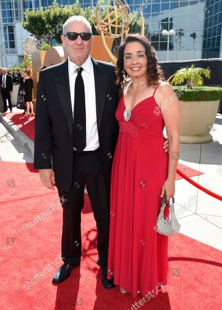 Ed O'Neill, left, and Catherine Rusoff arrive at the 67th Primetime Emmy Awards, at the Microsoft Theater in Los Angeles