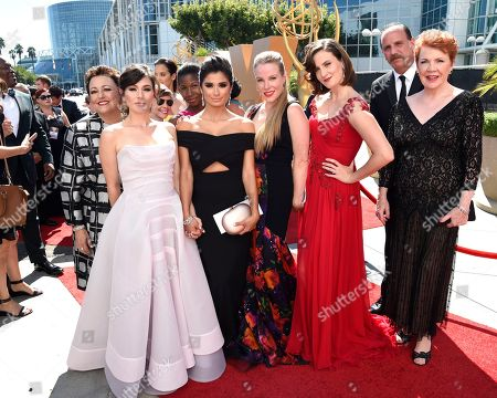 Stock Photo of Barbara Rosenblat, from left, Yael Stone, Abigail Savage, Lolita Foster, Diane Guerrero, Emma Myles, Julie Lake, Nick Sandow, and Beth Fowler arrive at the 67th Primetime Emmy Awards, at the Microsoft Theater in Los Angeles