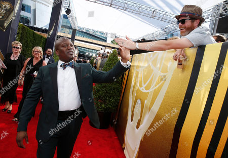 Titus Burgess arrives at the 67th Primetime Emmy Awards, at the Microsoft Theater in Los Angeles