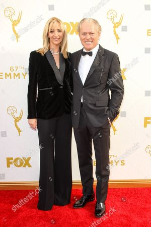 Lisa Kudrow, left, and Michel Stern arrive at the 67th Primetime Emmy Awards, at the Microsoft Theater in Los Angeles