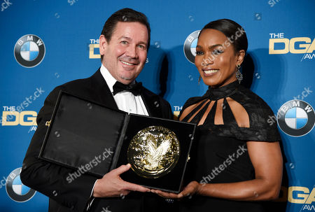 """Director David Nutter, left, poses with presenter Angela Bassett backstage after winning the Dramatic Series award for """"Game of Thrones"""" at the 68th Directors Guild of America Awards at the Hyatt Regency Century Plaza on in Los Angeles"""
