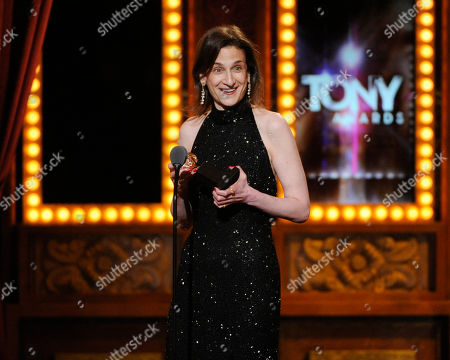 """Natasha Katz accepts the award for Best Lighting Design of a Play for """"The Grass Menagerie"""" on stage at the 68th annual Tony Awards at Radio City Music Hall, in New York"""